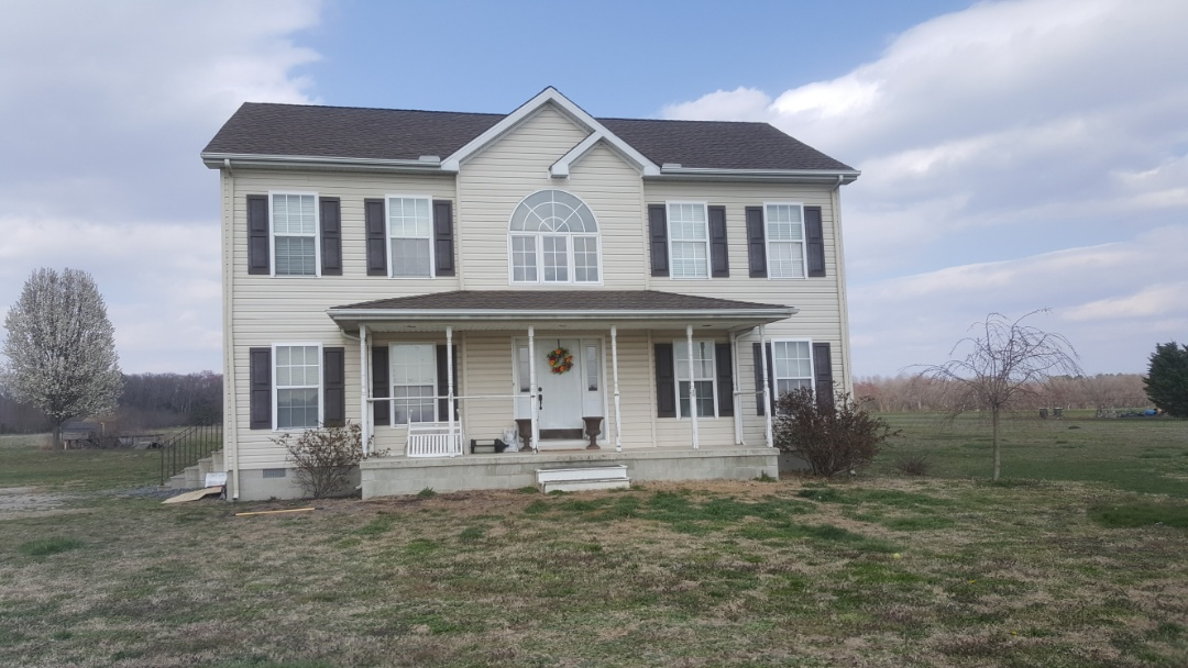 Seaford, DE - Spicer Bros Construction removed one layer of shingles from the roof deck and installed new GAF Timberline HD Shingles, barkwood in color. Home is located in Seaford, DE.