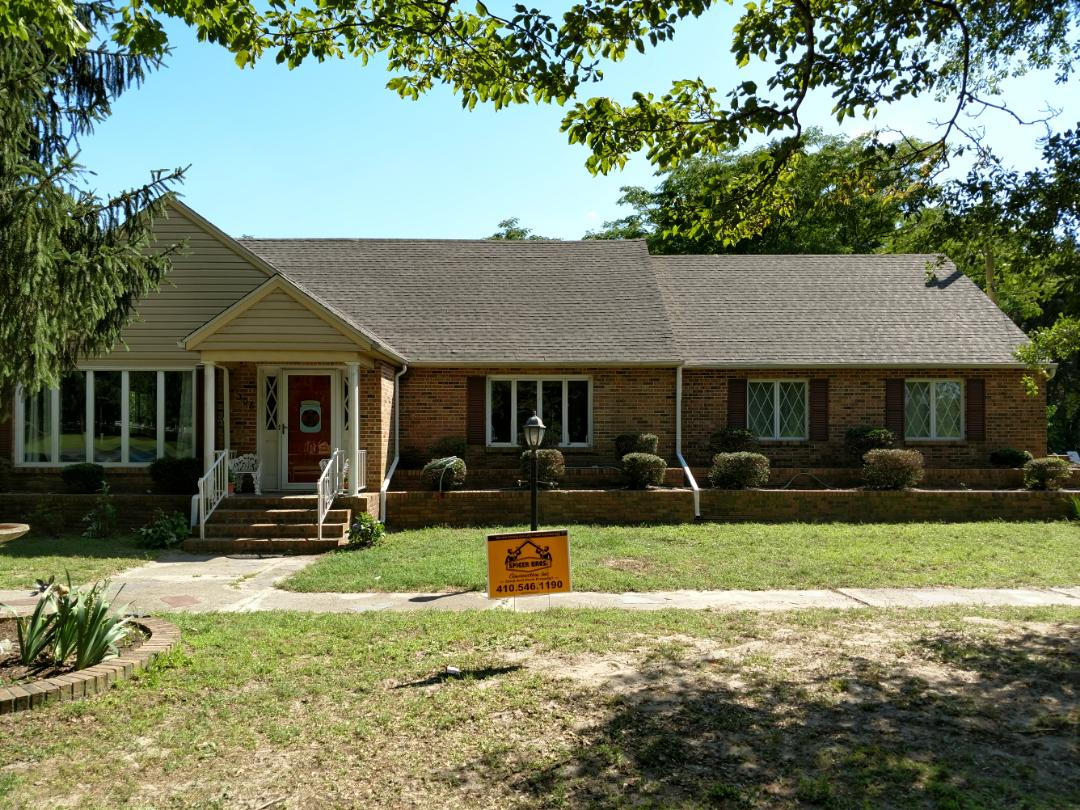 Salisbury, MD - Spicer Bros Construction removed three layers of shingles in Salisbury, MD and installed new GAF Timberline HD shingles Weathered Wood in color.