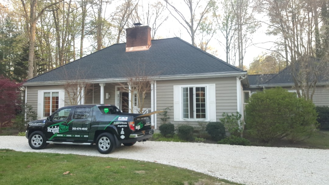 Lewes, DE - GAF Roofing install with copper chimney flashing and Hipvents!