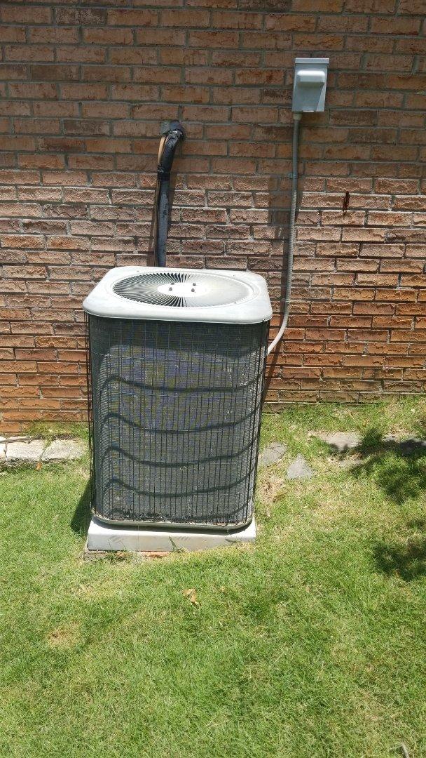 Working on a Lennox heat pump system in Ellerslie GA