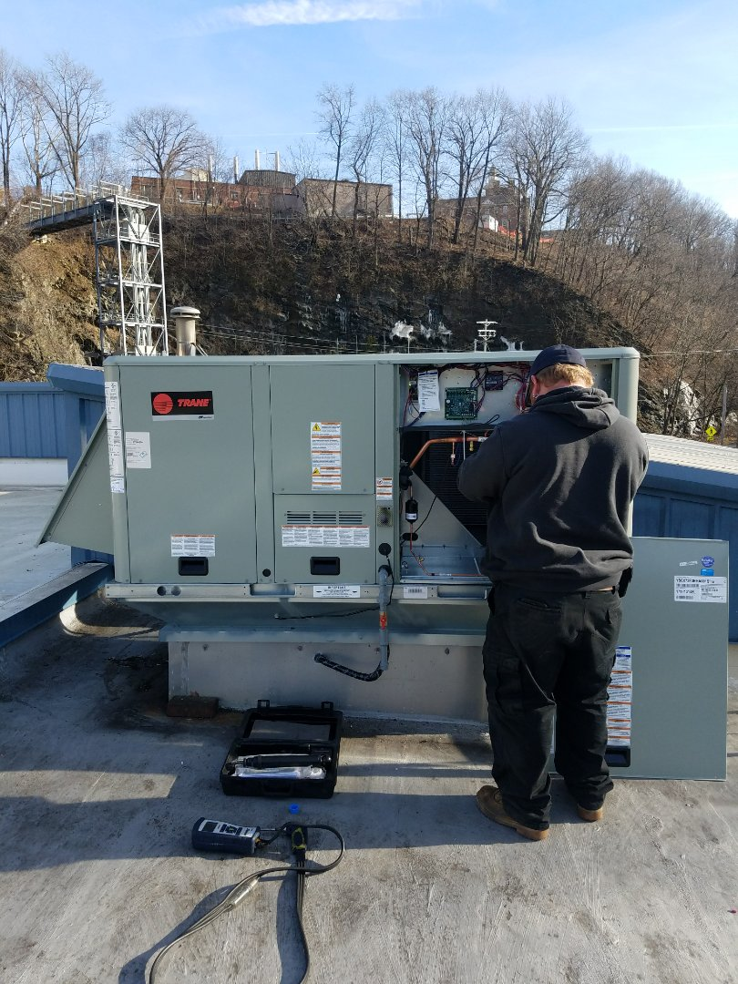 Easton, PA - Replacing York rooftop gas furnace with air conditioning and installation of new Trane rooftop gas furnace with air conditioning