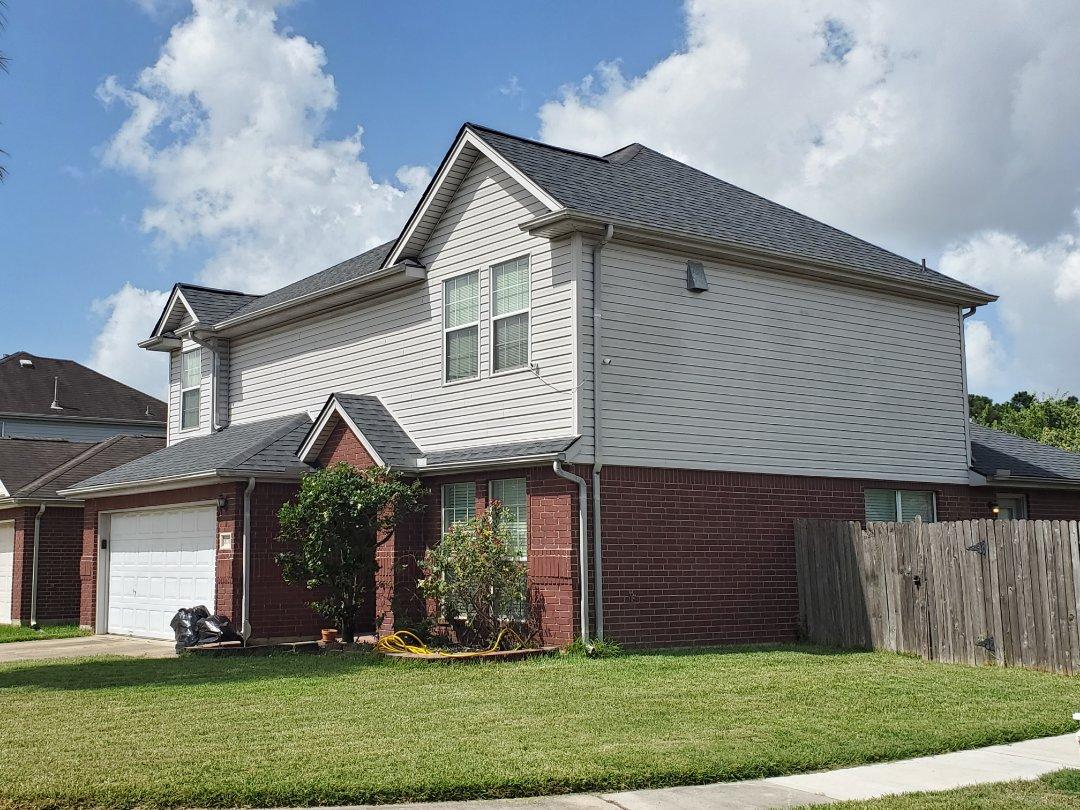 Houston, TX - Another happy customer! CertainTeed Landmark Moire Black re-roof.