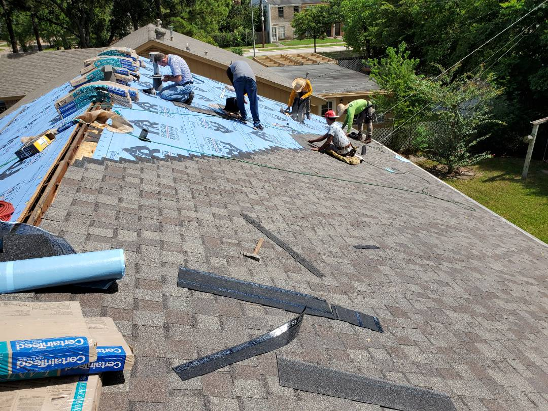 Houston, TX - Spring Branch hail storm 2019 is no match for the crew at Kirtley & Sons Roofing. Am customer getting a CertainTeed Landmark Weathered Wood roof.