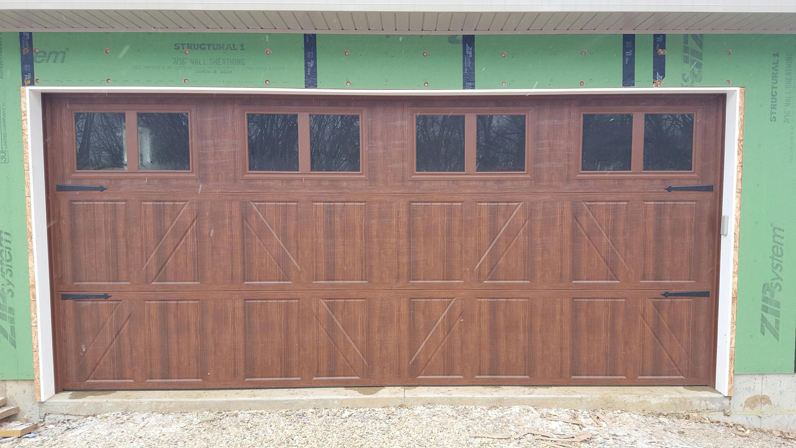 New garage doors and garage door repair serena il for 18x8 garage door