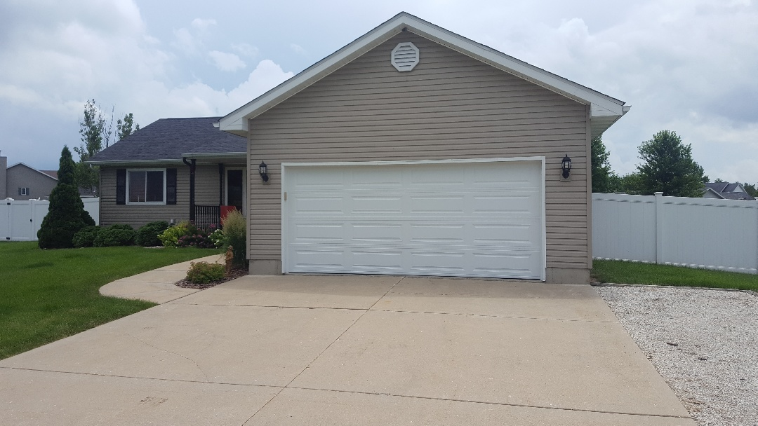 Dalzell, IL - 16 foot by 7 foot steel insulated door with long panel design.
