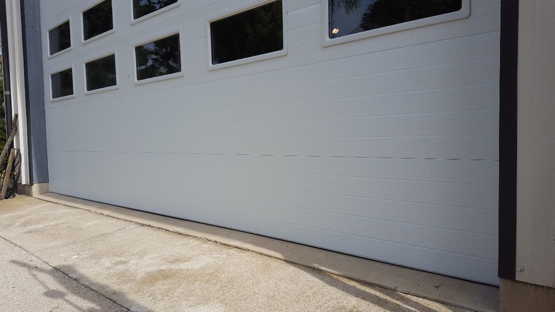 Earlville, IL - Replacement panels for a 20' commercial door.