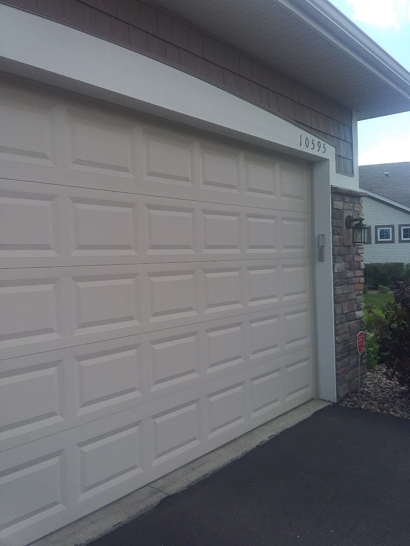 Garage door  tuned up and safety sensors  replaced