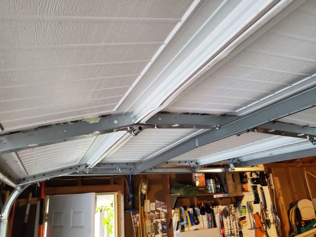 Garage door tune-up garage door adjustments garage door repair St Paul Minnesota