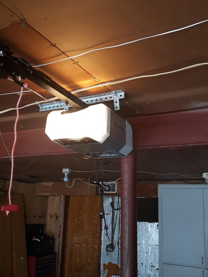 North Saint Paul, MN - Garage door service replace garage door opener and rollers