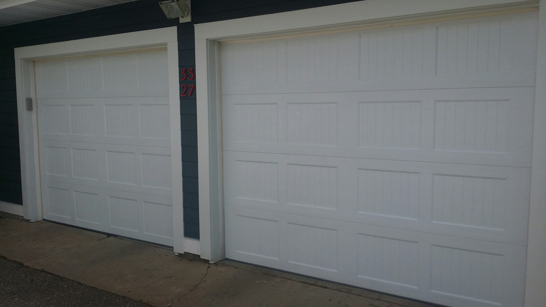Montrose, MN - Jon and Matt installed 2 North Central AR138 garage doors and 2 LiftMaster 8355 garage door openers