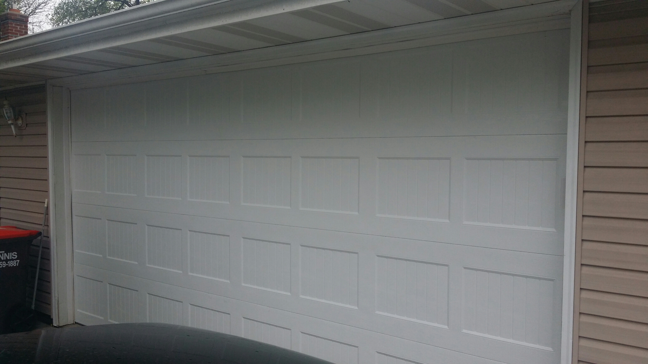 Maple Plain, MN - Garage door installation of North Central AR138 16x8 white garage door.