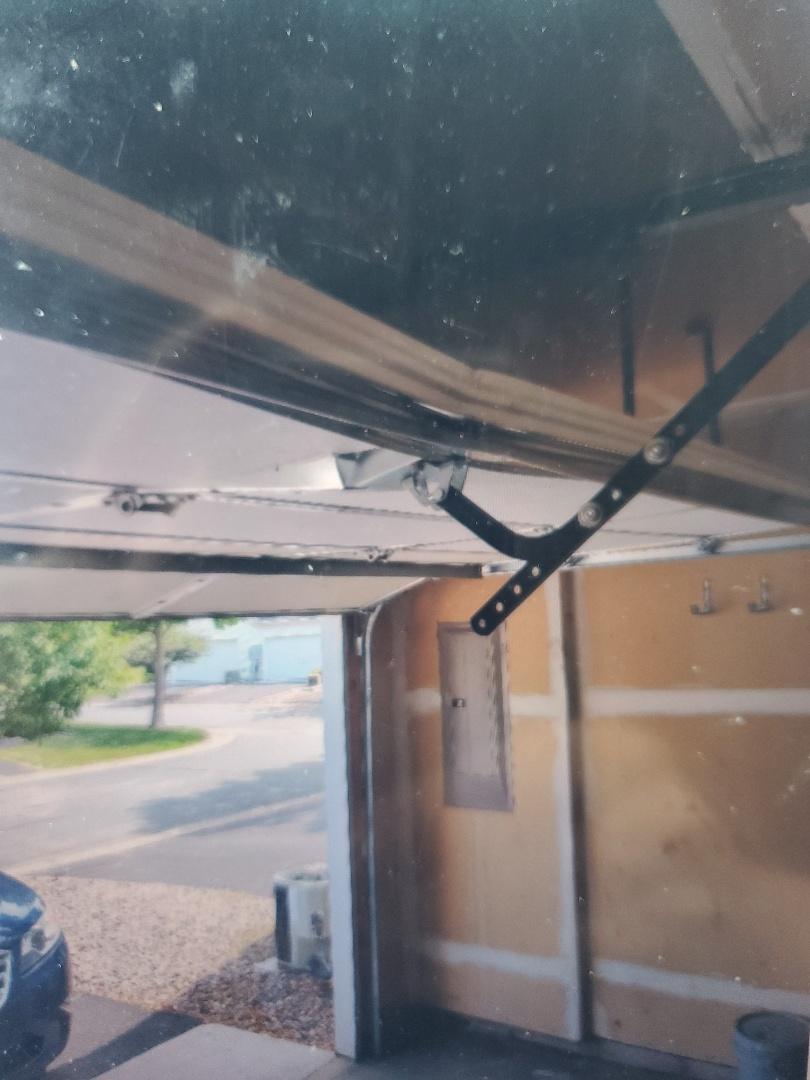 Lino Lakes, MN - Garage Door Service garage door repair section replacement Blaine Minnesota