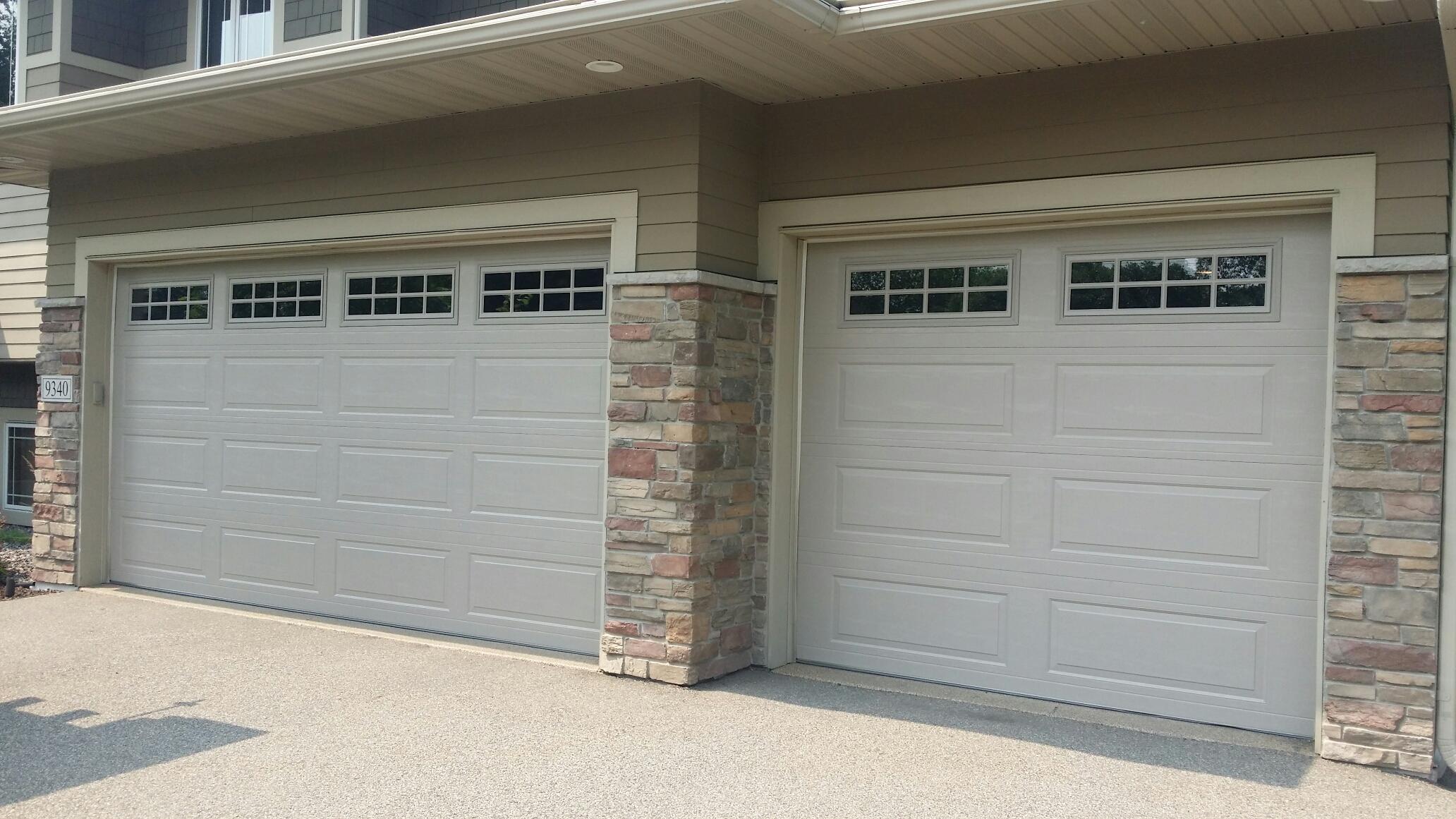 jon installed north central lp138 16x7 u00279 and 9x7u00279 garage doors
