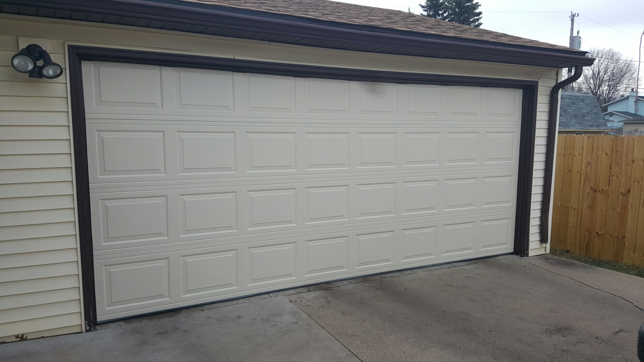 North Saint Paul, MN - Jon installed North Central RP25 16x7 Garage Door