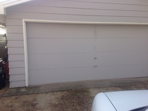 Maple Plain, MN - Chris just finished adjusting a garage door here in maple plain
