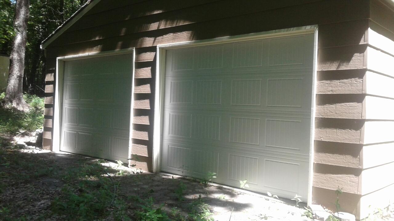 Long Lake, MN - Jon installed 2 North Central AR25 9x7 Garage Doors