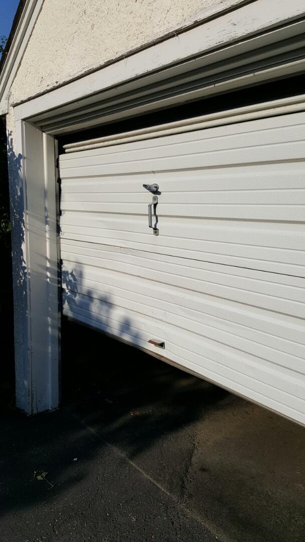 Lauderdale, MN - Damaged garage door sections garage door repair straighten bent garage door sections