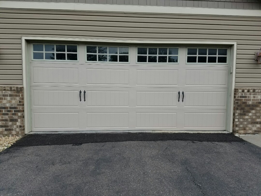 North Oaks, MN - Garage door torsion spring replacement