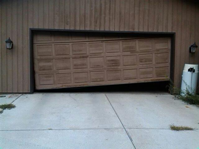 Lake Elmo, MN - car stuck in the garage. need a new garage door