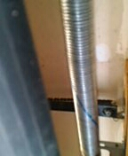 Chanhassen, MN - Replace torsion spring and end bearings