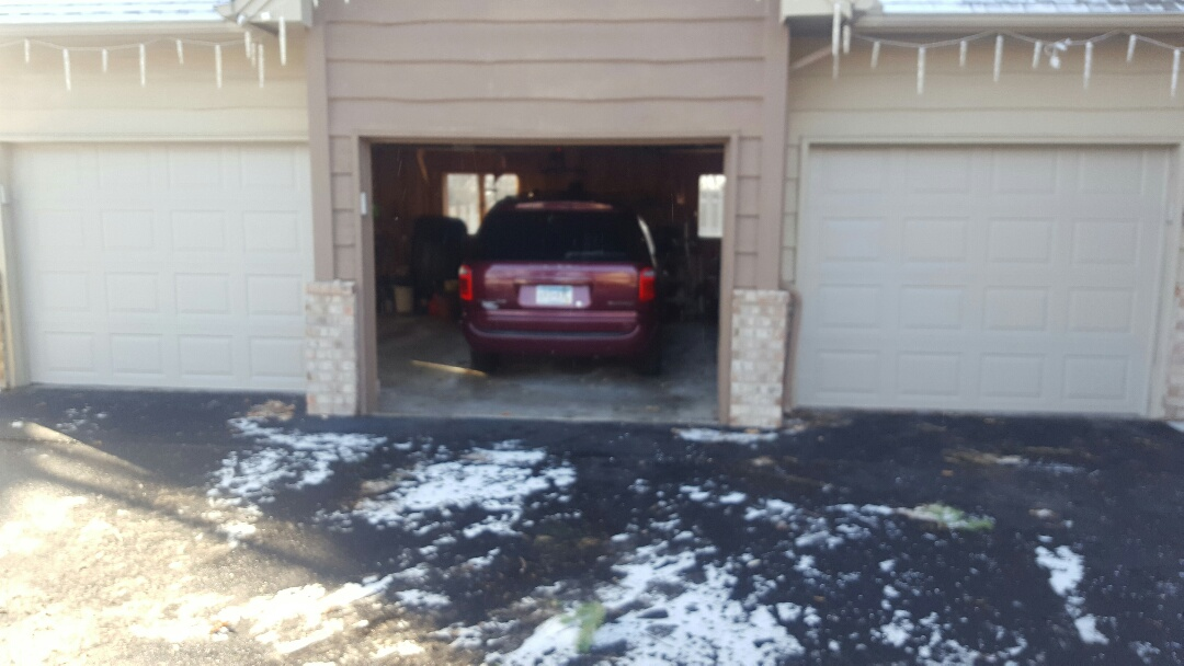 Osseo, MN - Jeremy installed two 9 by 7 garage doors