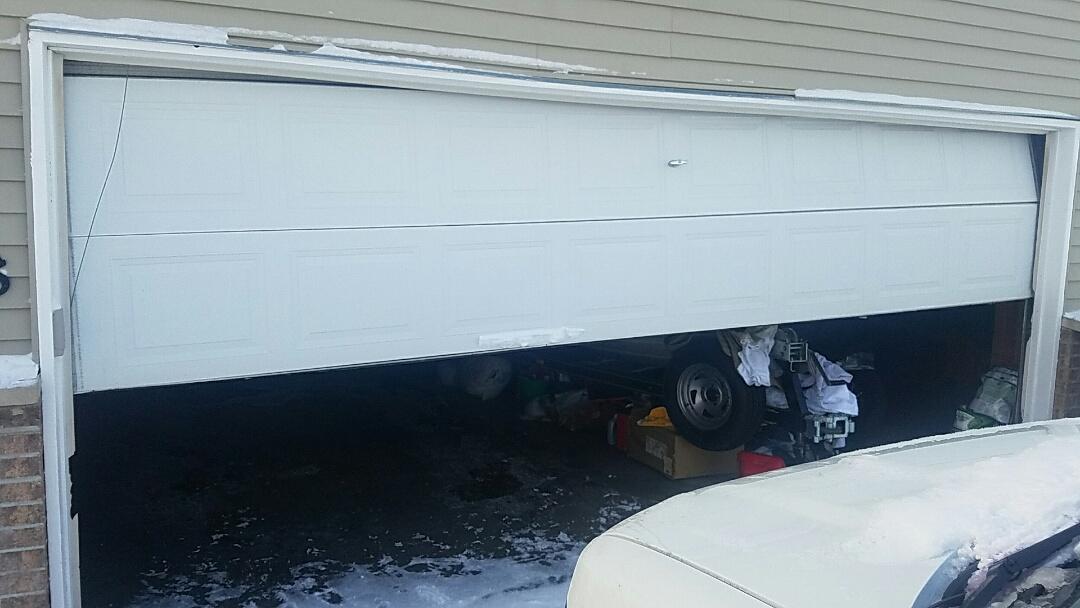 Savage, MN - Garage door repair garage door spring replacement garage door cable replacement door stuck in track Savage Minnesota