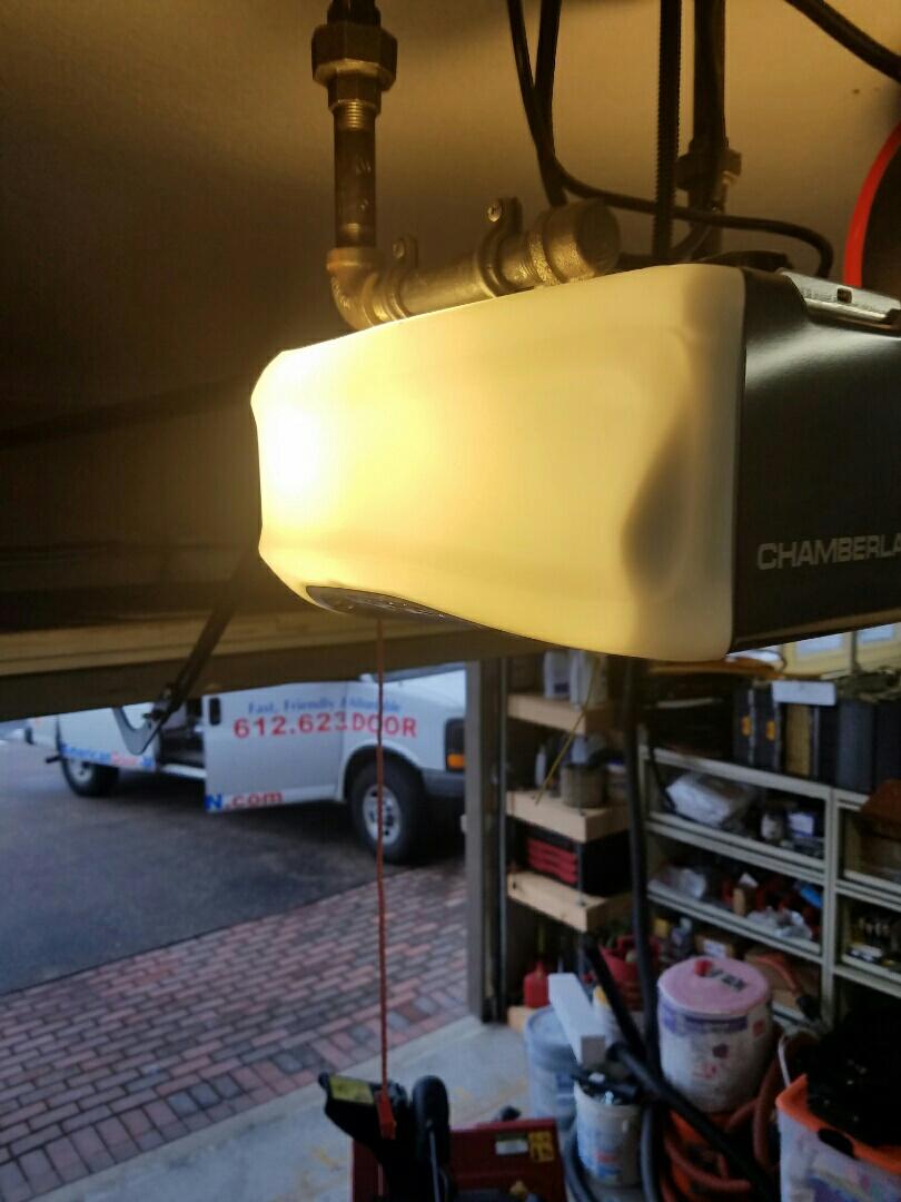 Coon Rapids, MN - Photo a replacement garage door service garage door