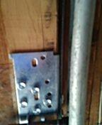 Andover, MN - Garage Door Service garage door cable and bottom fixture replacement