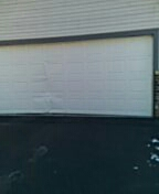 Mahtomedi, MN - Damaged garage door garage door section estimate