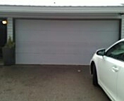 Minnetonka, MN - Garage door service. Torsion spring replacement