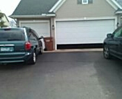 Mahtomedi, MN - Garage door service,torsion spring, end bearings and bottom seal