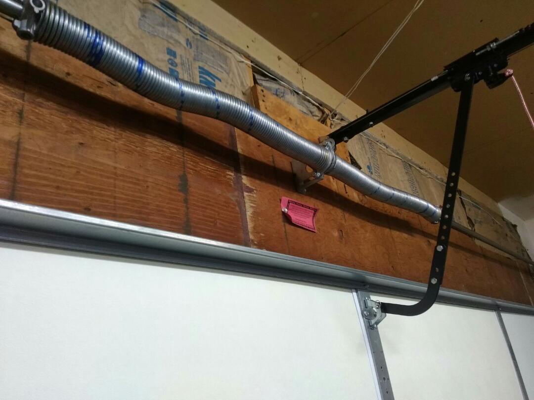 Lakeville, MN - Garage door service torsion springs replacement