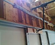 Montrose, MN - Garage door service. Torsion spring replacement and end bearings