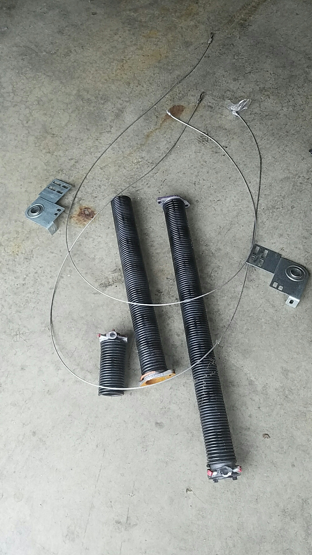 Brooklyn Park, MN - Replaced garage door Springs and end bearings and cables