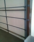 Mendota Heights, MN - Garage door service replace bottom fixtures and cables door off track