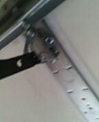 Woodbury, MN - Garage door service replace opener bracket.