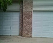 Lakeville, MN - Garage door service replace garage door opener and install new battery on opposite operator