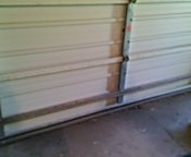 Garage door service replace bottom seal and reattach operator
