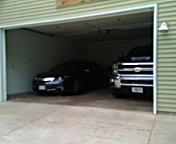 Stillwater, MN - Garage door service replace bottom fixtures and cables and bottom seal.