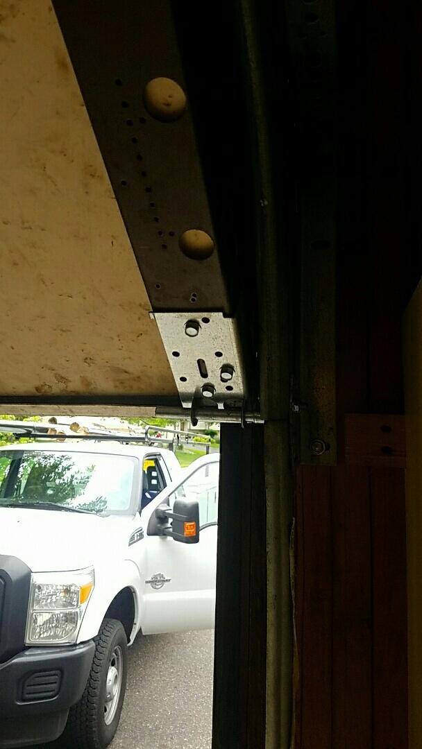 Blaine, MN - Garage Door Service garage door repair torsion Tube replacement and bearing replacement Blaine Minnesota