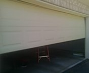 Chanhassen, MN - Garage door service replace bottom fixtures and cables, and operator circuit board blonking