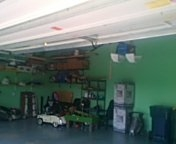 Lakeville, MN - Garage door service install customer purchased garage door opener and switch current opener to second stall.