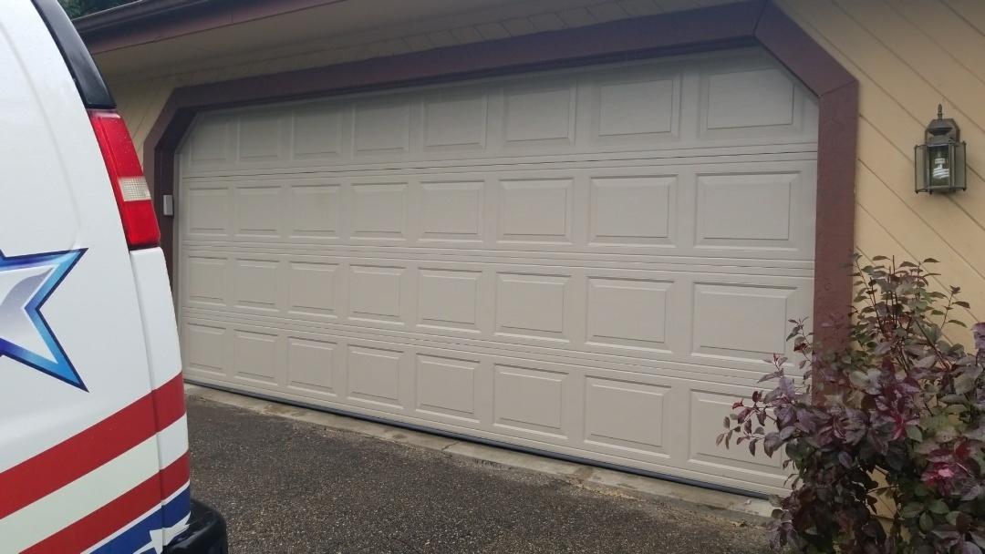Eden Prairie, MN - Garage door service replaced trim and bottom seal