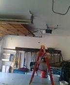 Lakeville, MN - Garage door service replace cables and install customer purchased garage door opener
