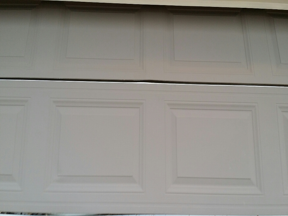Medina, MN - Garage door section replacement estimate