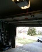 Garage door service misaligned safety eyes