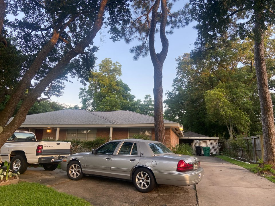Houston, TX - Another happy customer! Garage re roof complete.