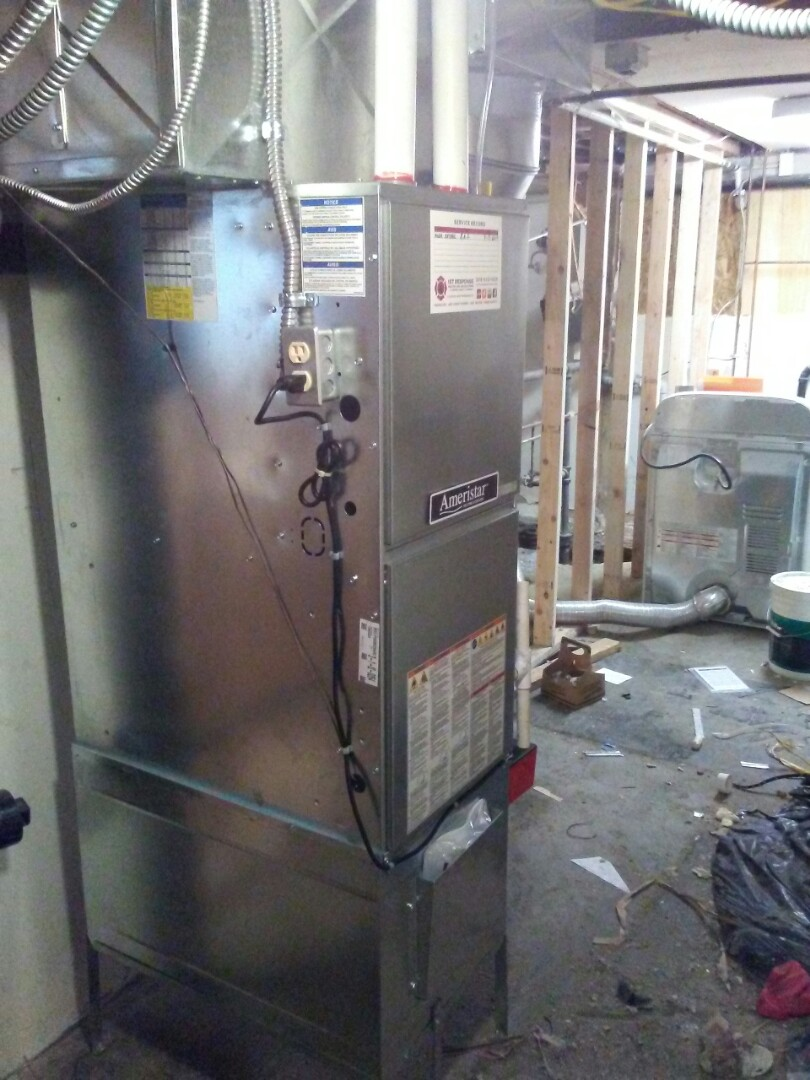 Seattle, WA - Installing high efficiency gas furnace.