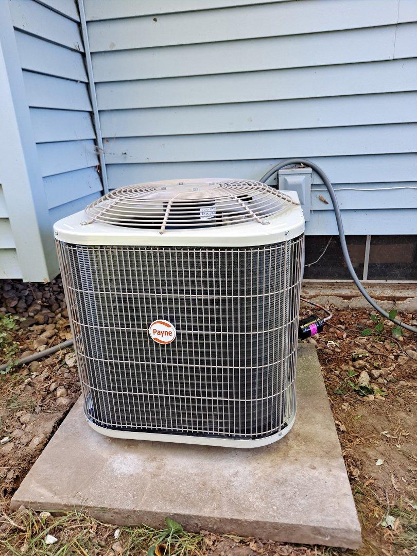 Installation of Payne Air conditioner.
