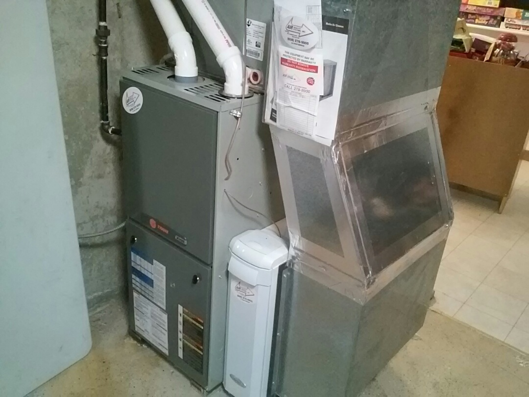 Oregon, WI - Furnace services and maintenance. Trane unit.